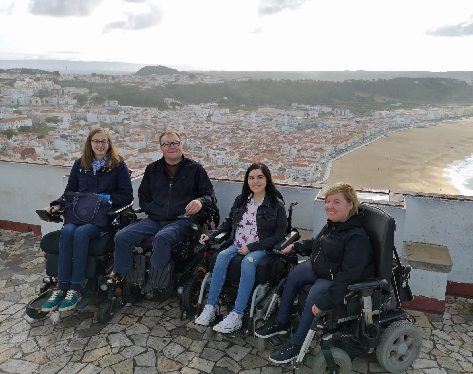 Emma with three accessible travel bloggers who are all in powered wheelchairs. Blandine, John, Emma and Sanna.