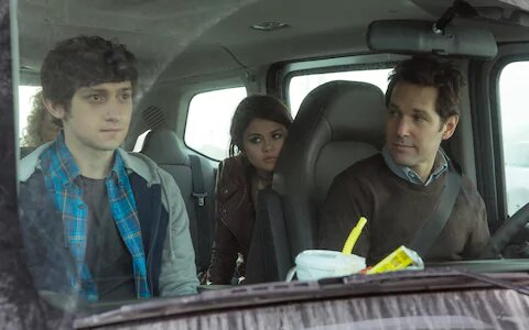 Trevor, Ben and Dot sitting in the car on their road trip.