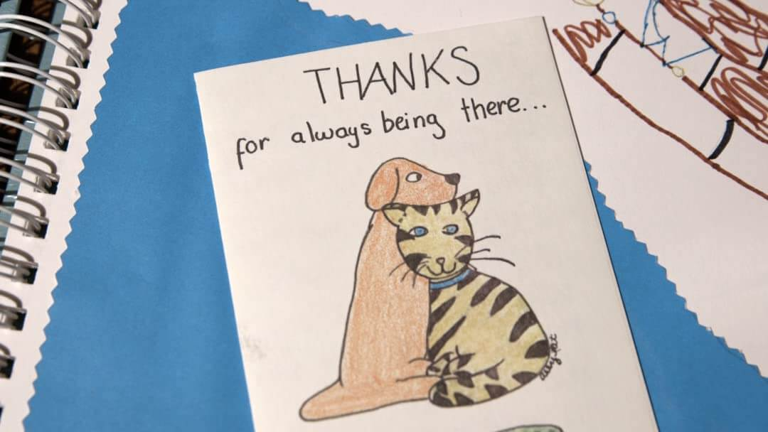 A thank you card showing a cat and dog. Alyssa made this card for her OT.