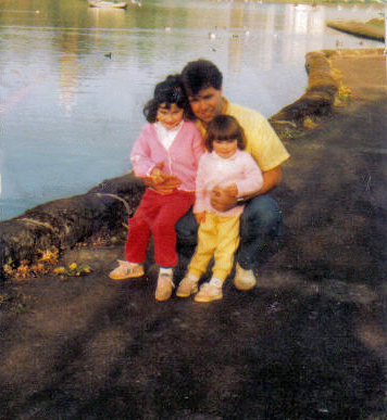 Emma around the age of 3 with her dad and sister at Linlithgow Loch.