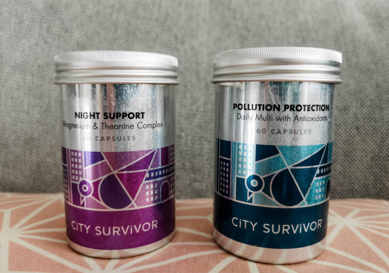 Two metal tins containing supplements. Pollution Protection has a blue design on the tin and Night Support has a purple design.