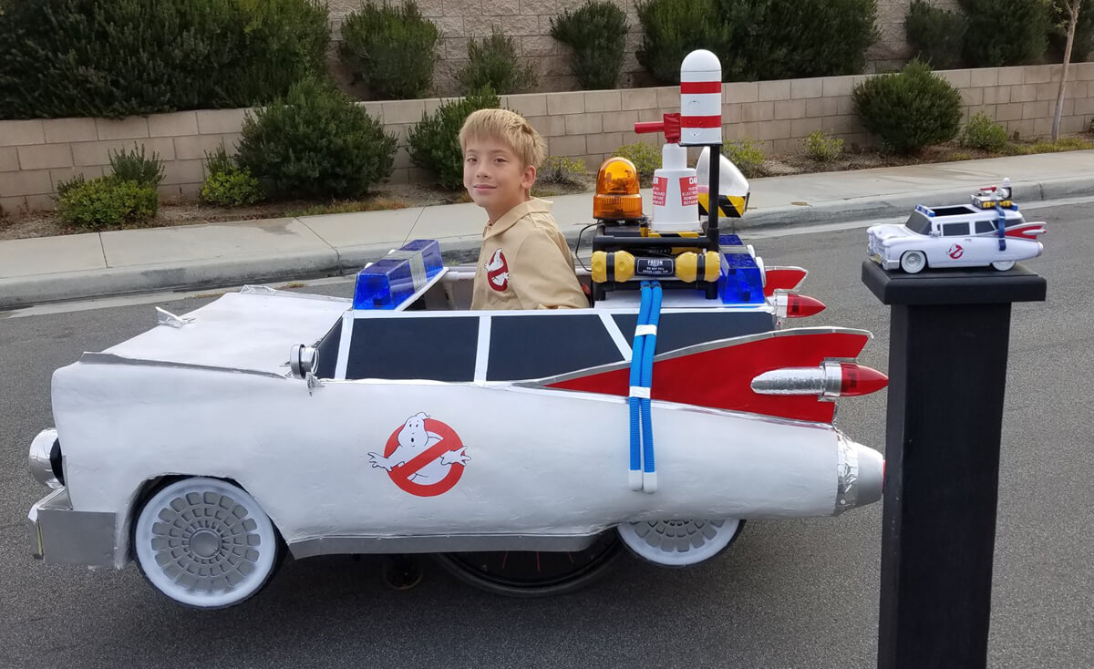 A young boy in a wheelchair dressed up as a Ghostbuster in this Ghostbuster theme halloween wheelchair costume.