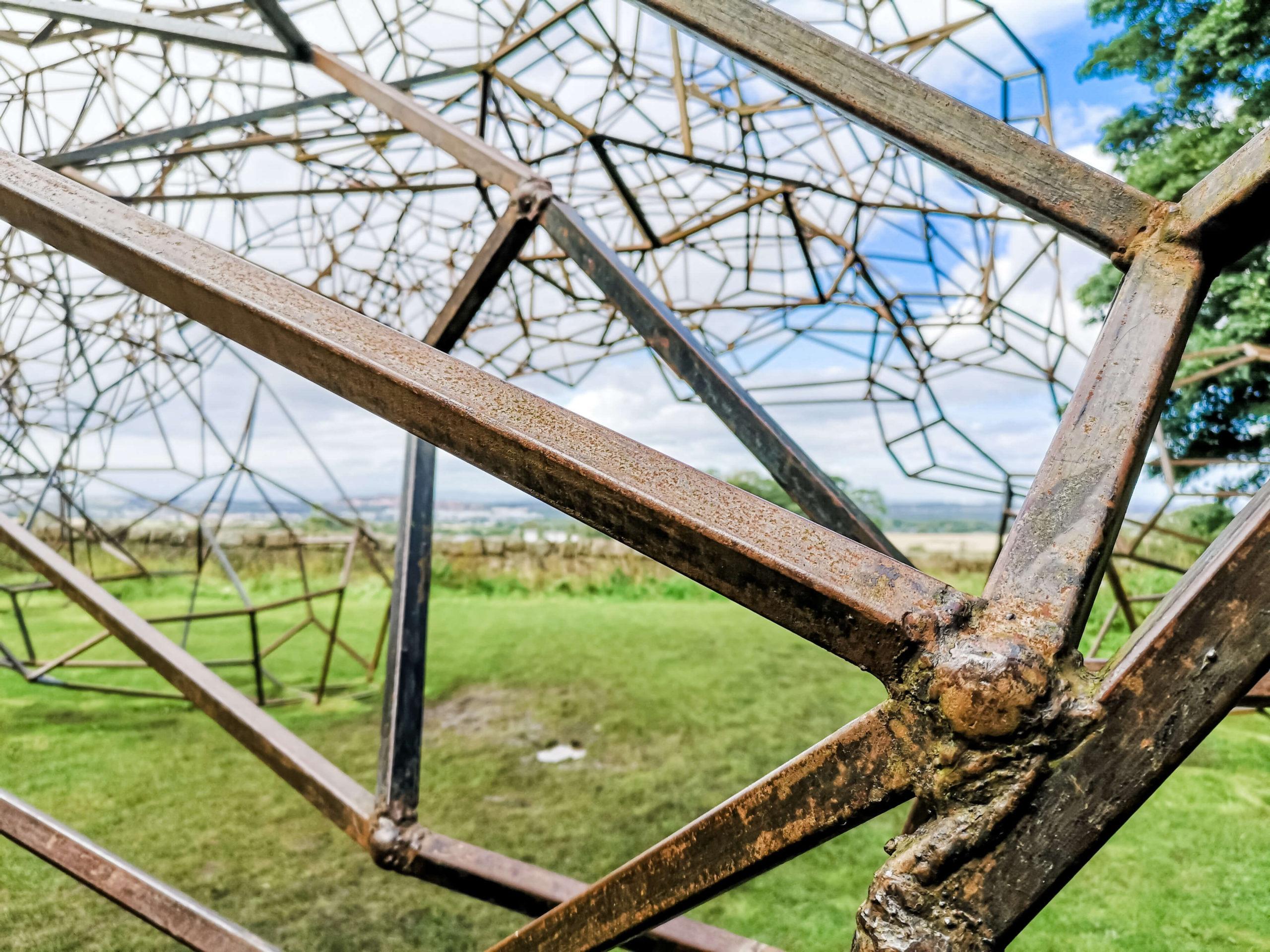 A close up shot of Antony Gormley sculpture called 'Firmament' at Jupiter Artland.