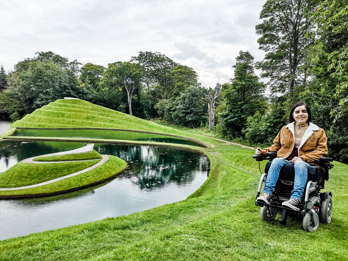 Emma is driving up the swirly grass mounds of 'The Cells of Life' at Jupiter Artland Edinburgh.