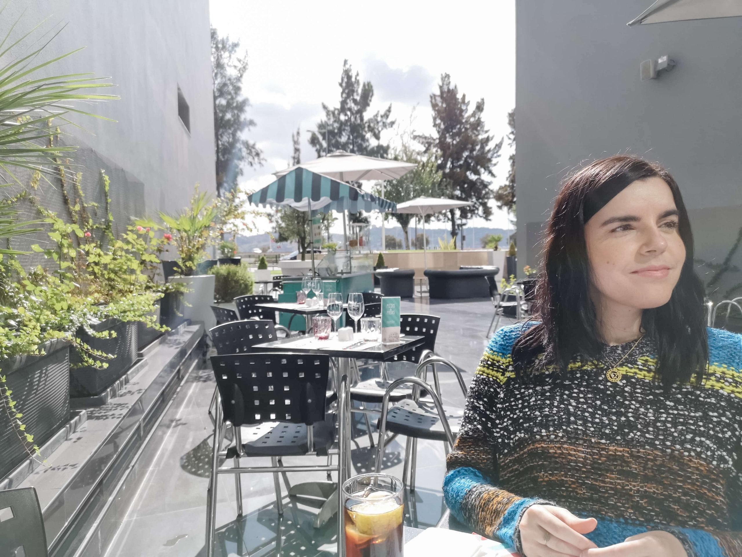 Emma sitting outside sitting lunch at Vila Gale Opera hotel Lisbon.