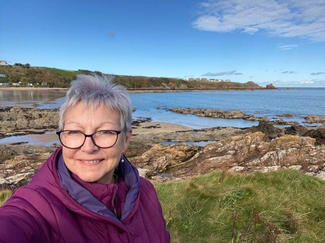 A woman taking a selfie at Coldingham Sands Beach