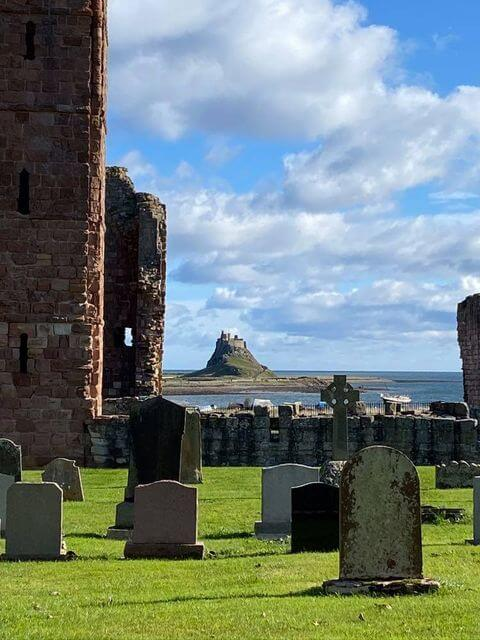 A view from a Church yard across to The Holy Island of Lindisfarne