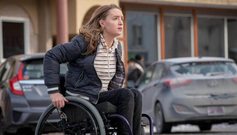 Scene from the movie Run showing actress Kiera Allen pushing her wheelchair in the street.
