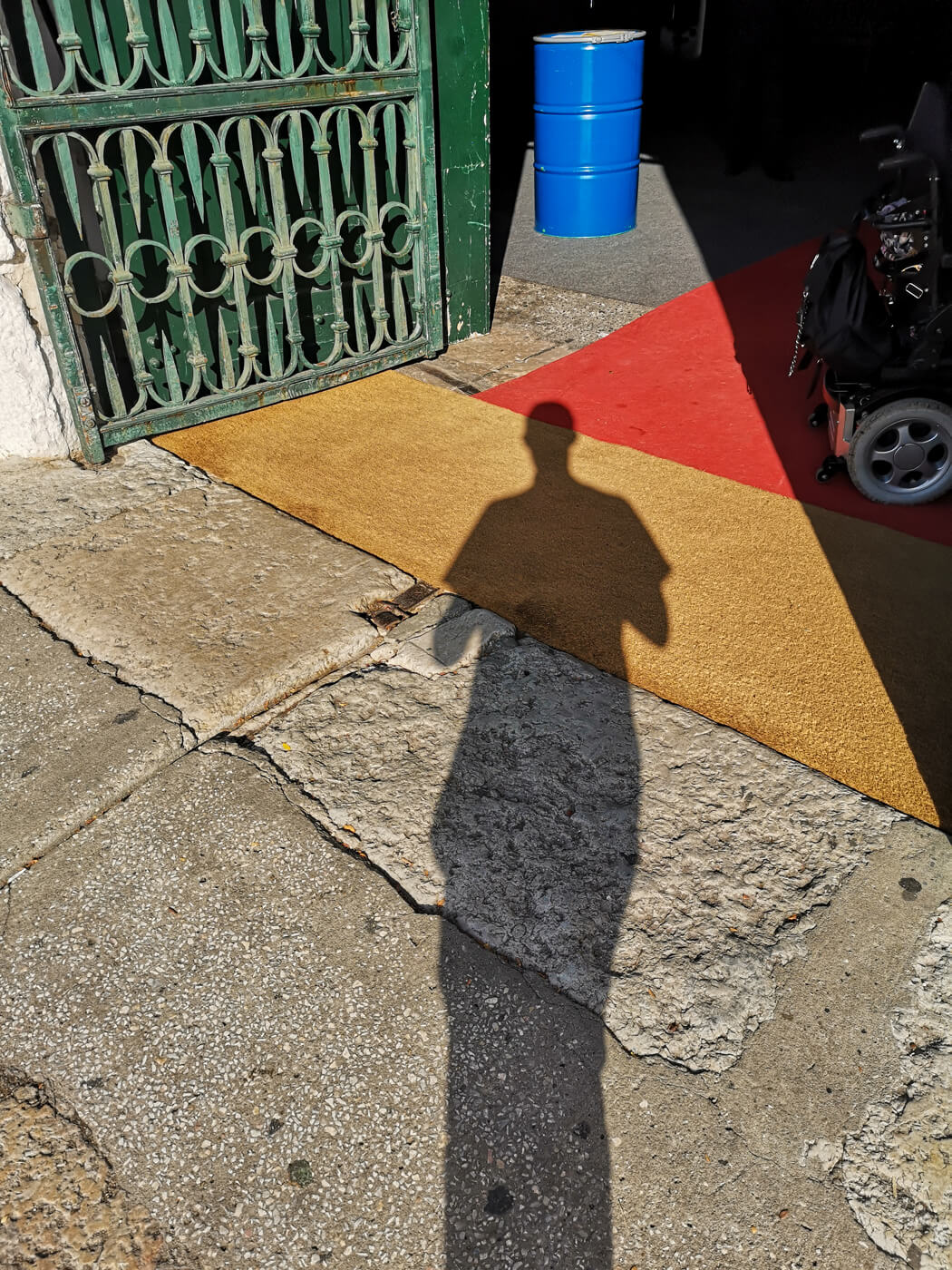 A mans shadows standing at the entrance of Banksy: Genius or Vandal exhibition Lisbon