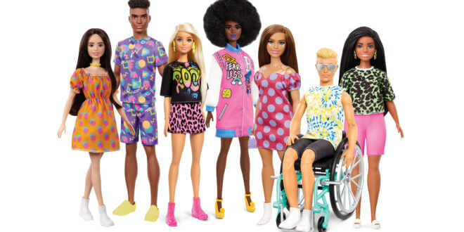 A collection of Barbie Dolls with a range of looks including Ken in a wheelchair.