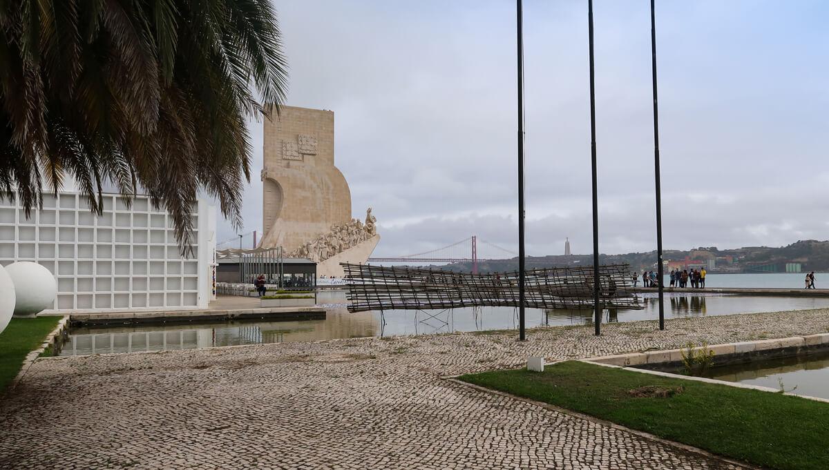 A view of the Belem Tower, Tagus River and 25 April Bridge from the entrance of Espaço Espelho d'Água