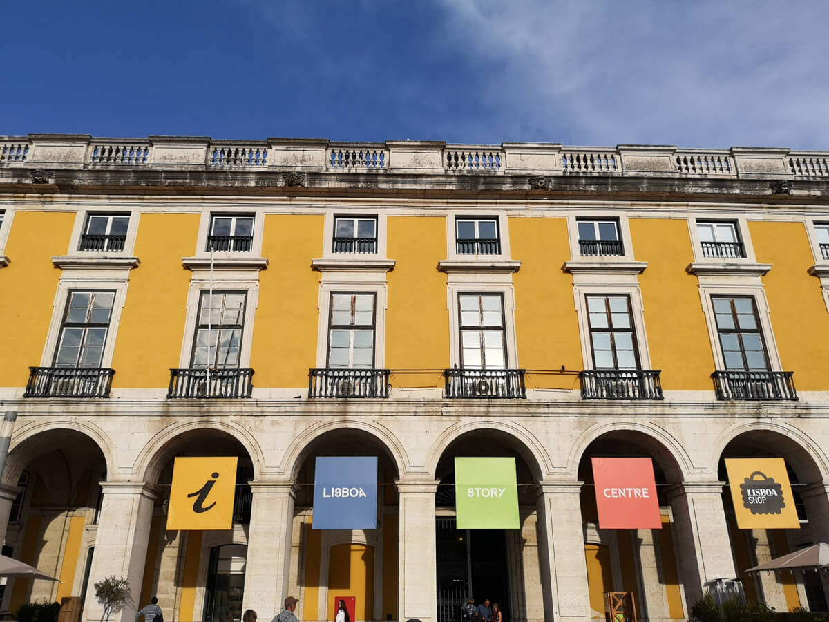 The exterior of Lisbon Story Centre, a large bright yellow building.