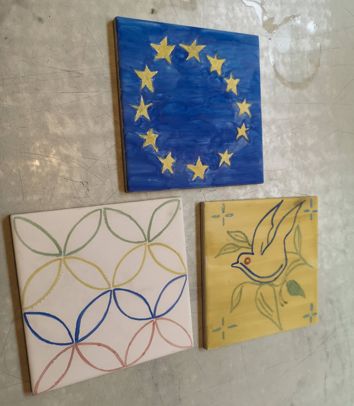 Three decorated tiles made by Emma, Allan and John at National Tile Museum in Lisbon