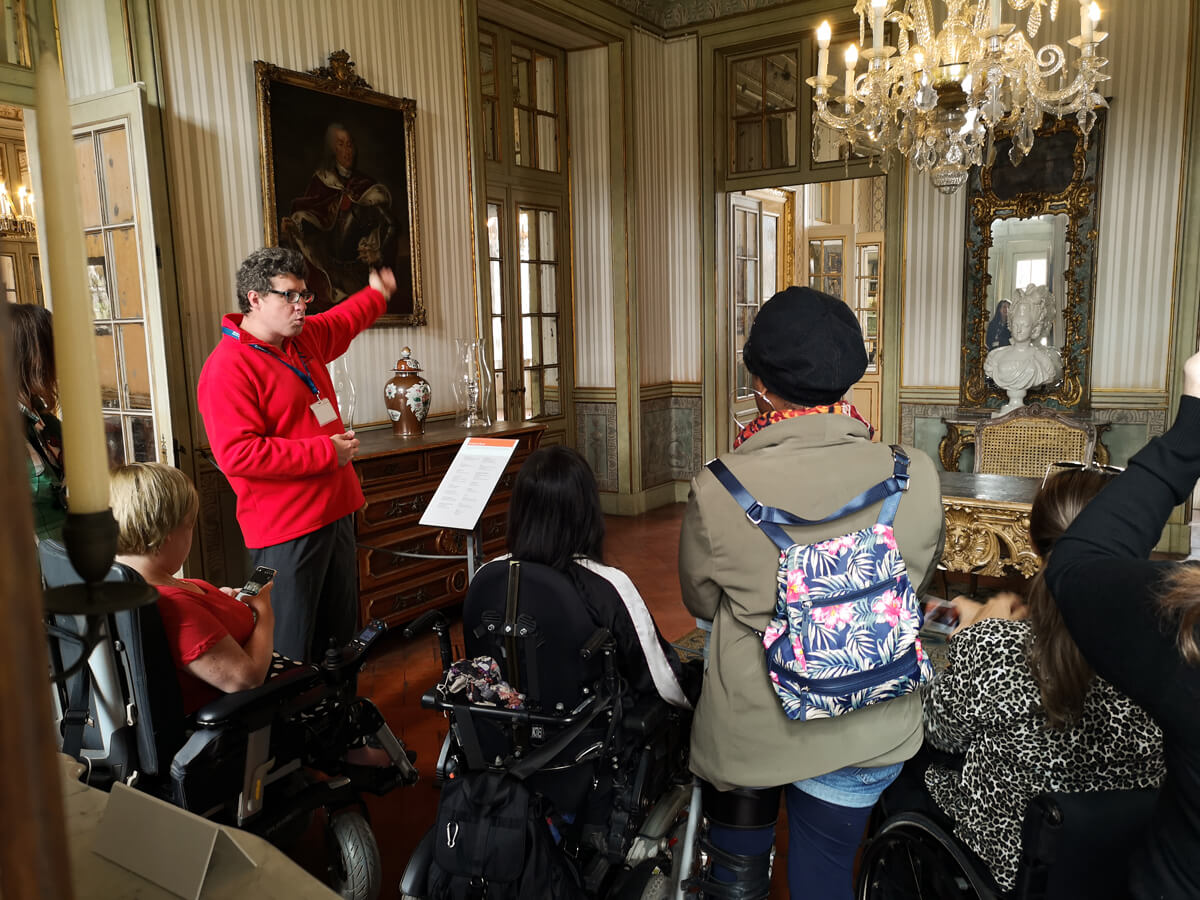 Emma a wheelchair user and her group of fellow disabled travellers having a guided tour at Royal Palace of Queluz