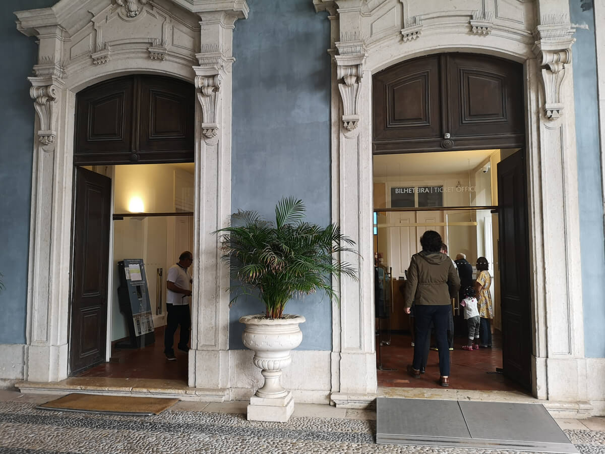 The entrance to the ticket office at Royal Palace of Queluz showing a wheelchair ramp at the door.