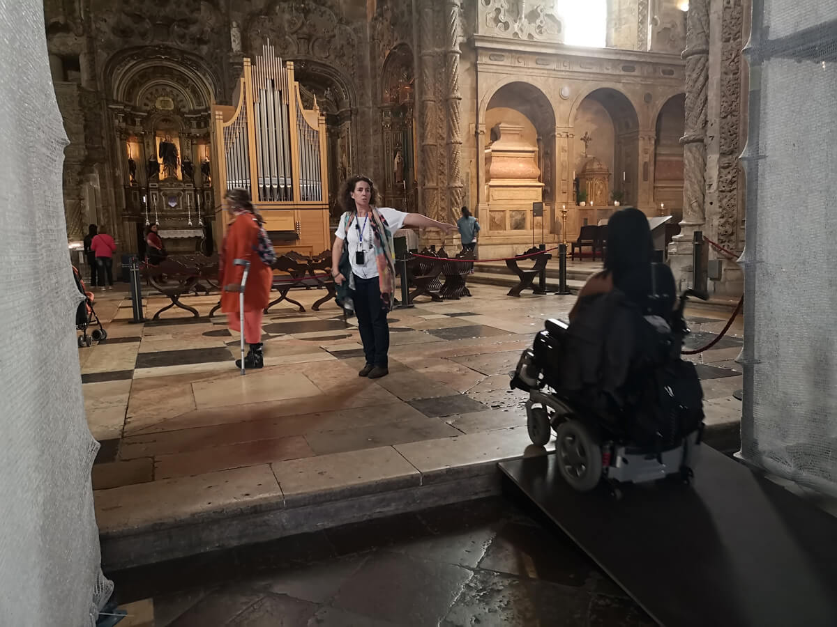 Emma driving her wheelchair up a ramp in Saint Jerome Monastery
