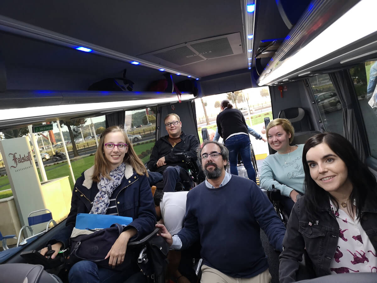 Emma, John, Blandie, Sanna and tour guide Pedro sitting together at the back of the bus.