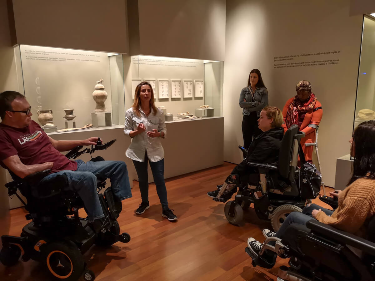 A group of wheelchair users participating in a tour of Batalha Conselhia Community Museum.