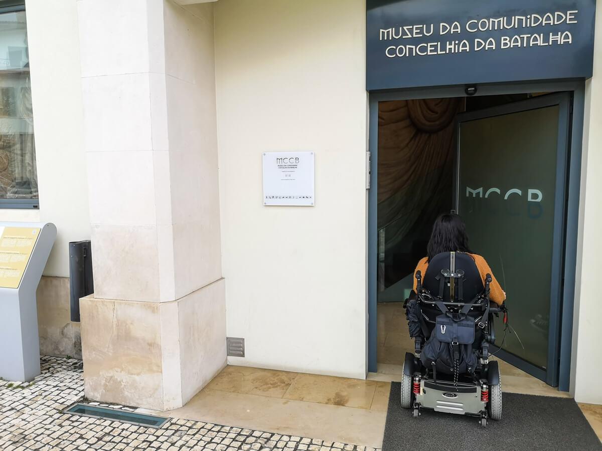 Emma, a wheelchair user driving into Batalha Conselhia Community Museum
