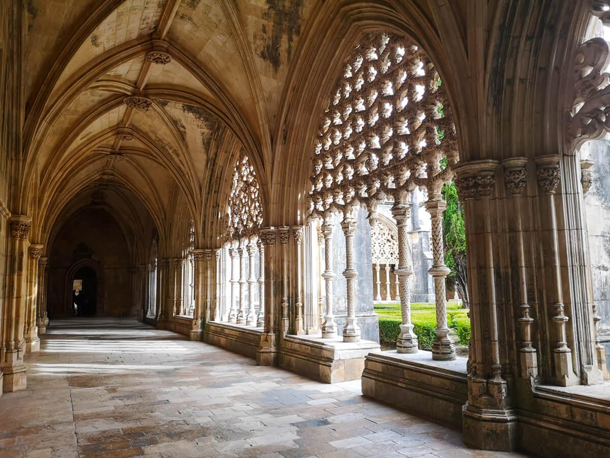 The arched walkways inside Batalha Monastery