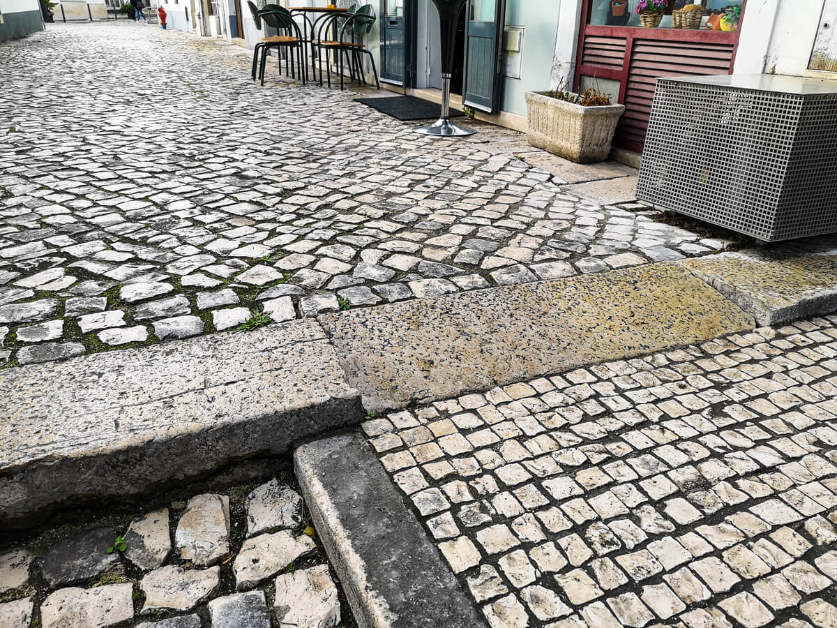 A close up shot of a cobblestone path and ramped kerb in Batalha town centre.