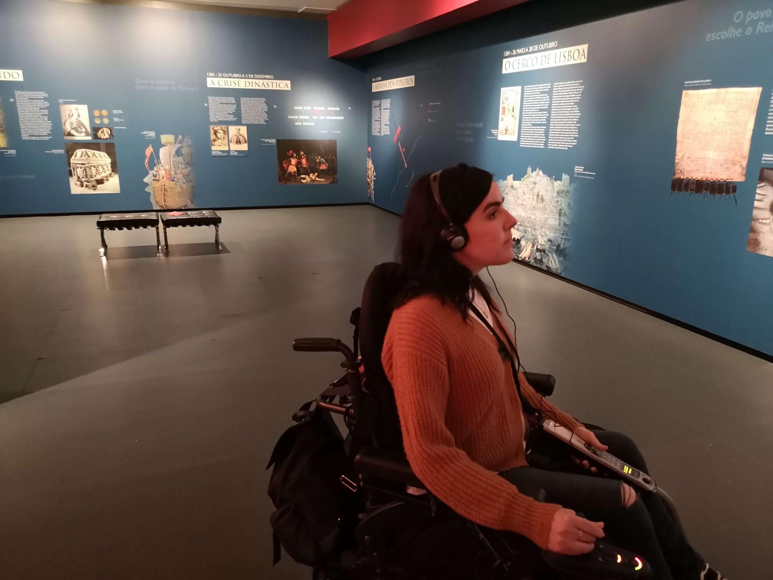 Emma wearing an audio headset listening to the history at Interpretation Centre of Aljubarrota Battle