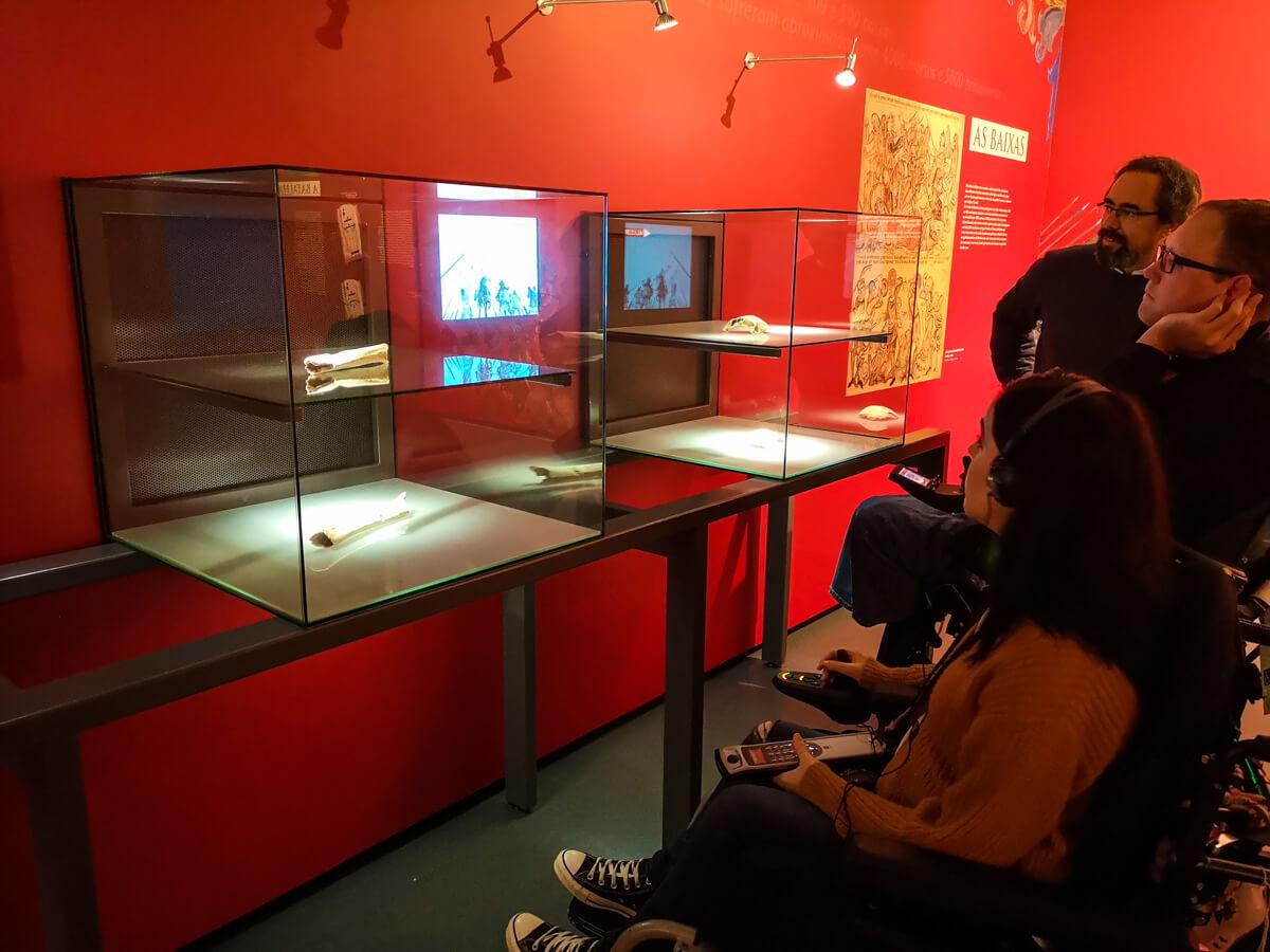 Emma, John and tour guide Pedro looking at displays inside the Interpretation Centre of Aljubarrota Battle
