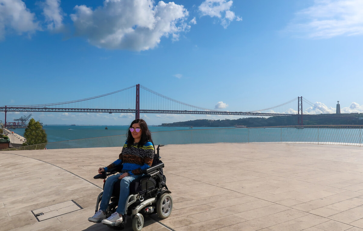 Emma at the top of the Museum of Art, Architecture and Technology admiring the view of the Tagus River and 25 April Bridge.