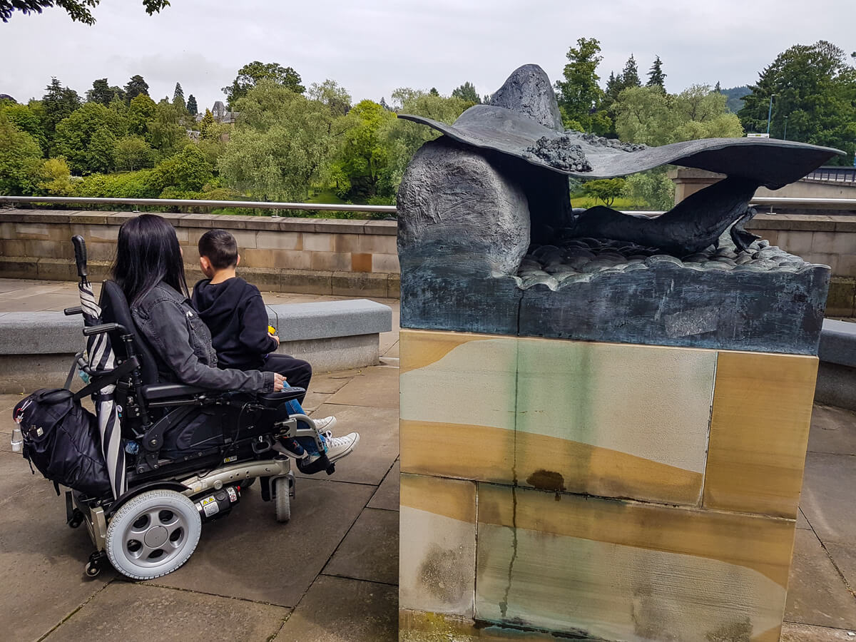 Emma and her nephew looking at one of the sculptures on the River Tay Public Art Trail