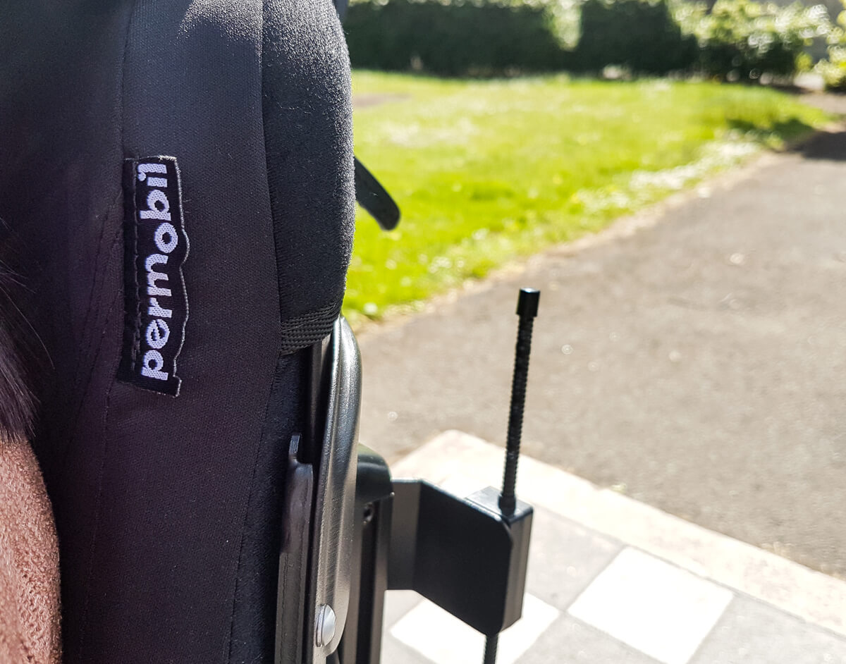 A close up shot of Permobil logo of the backrest cushion.