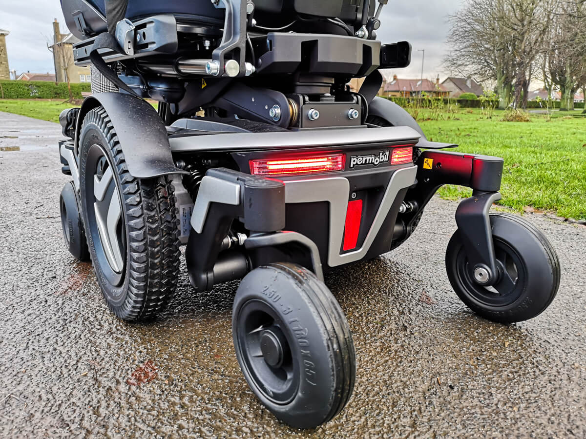 A close up shot of the back of the Permobil M3 powerchair with the back LED lights turned on.