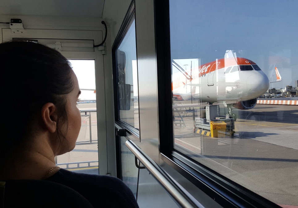 Emma sitting in her wheelchair inside the ambulift truck waiting to board the easyJet plane.