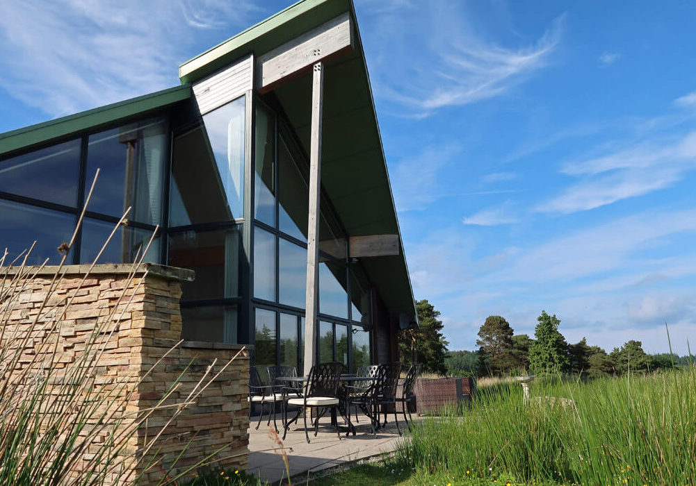 An exterior shot of The Straker chalet from the back showing the private outdoor terrace