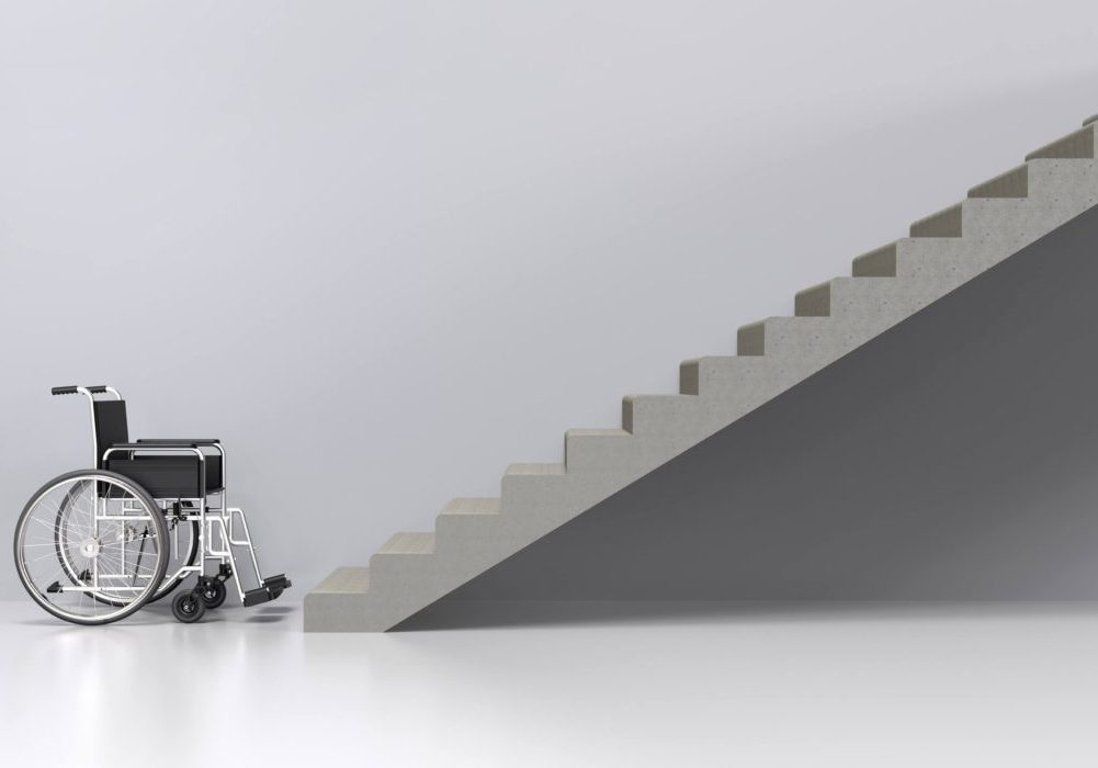 Wheelchair sitting at the bottom of stairs. How To Make Your Home Wheelchair Accessible