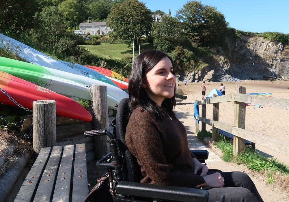 Emma smiling while enjoying the view at Aberporth Beach.