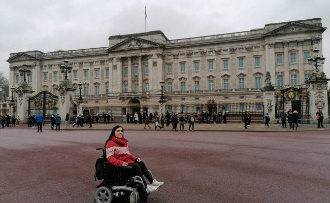 Emma posing outside Buckingham Palace