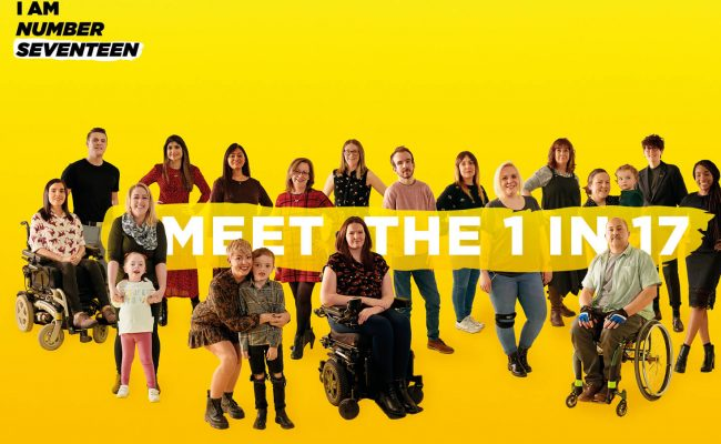 A yellow background with seventeen people with a range of rare conditions posing. A banner is floating across the photo with the words