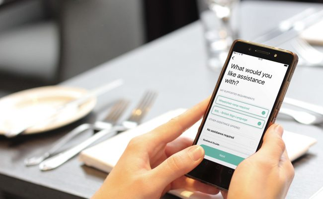 Hands holding a mobile phone with the Welcome app on screen.